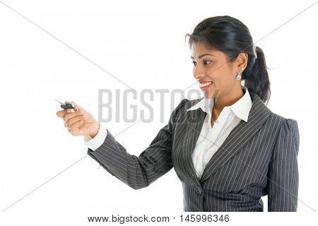 Female Indian car dealer hand over vehicle key to client, isolated on white background.