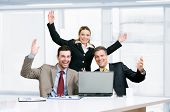 Happy smiling business team celebrate their new success in their modern office poster