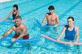 Healthy group of people exercising with aqua tube in a swimming pool poster
