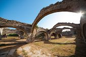 Ruin of The Venetian arsenal at Gouvia Corfu. The arches of the docks. poster