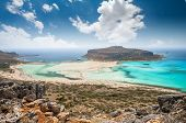 Balos lagoon on Crete island, Greece. Tourists relax and bath in crystal clear water of Balos beach. poster