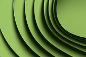 background monochrome macro image of a green paper origami pattern made of curved shapes. poster