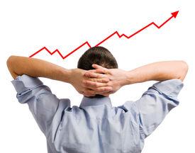 Joven empresario mirando su participación creciente. Negocio saludable y exitosa!