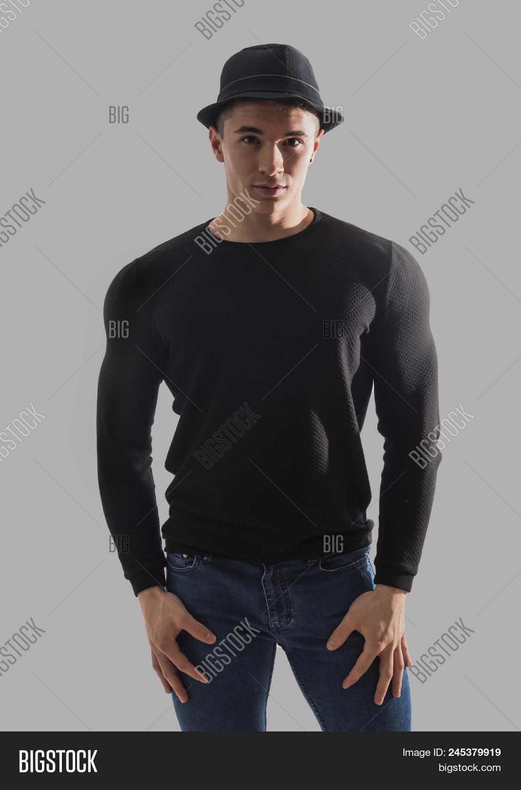 6cbe45a7eb4ae Handsome Young Muscular Man Looking At Camera In Studio Shot
