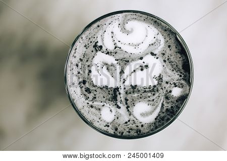 Beautiful Activated Charcoal Latte With Rose Pattern. Goth Black Trendy Latte