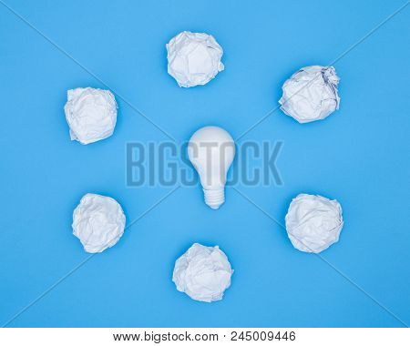 Creativity Inspiration, Ideas Concepts With Light Bulb And Paper Crumpled Ball On Pastel Color Backg