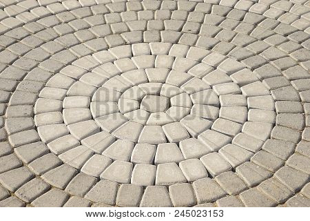 Stone Pavement In Perspective. Stone Pavement Texture. Granite Cobblestoned Pavement Background. Abs