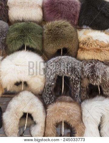 Natural Fur Hats. Handmade Wool Fur Headdress Shop Bazaar In Bukhara, Uzbekistan. Selling Group Of D