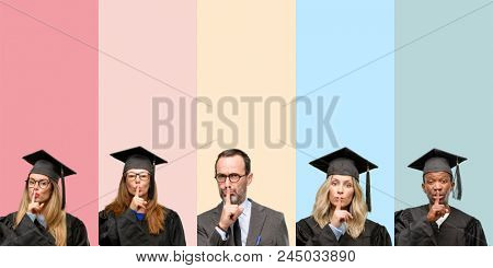 Senior teacher with his graduate students with index finger on lips, ask to be quiet. Silence and secret concept