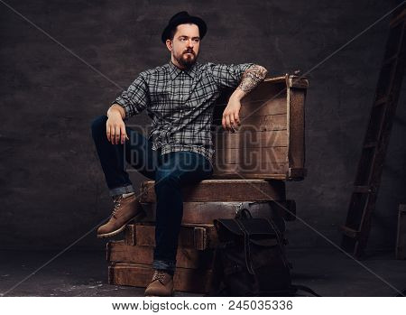 Full Body Portrait Of A Tattoed Middle Age Hipster Man Dressed In A Checkered Shirt, Jeans And Hat,