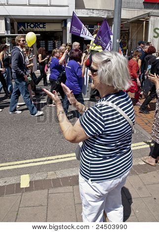 Passerby applauds the marchers as they walk the streets at the strikers march through Exeter City Ce