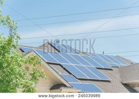 Solar Panel Installation On Asphalt Shingles Rooftop