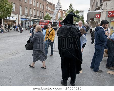 The Grim Reaper prowls the streets and stalks the people of Exeter during the Protest against NHS re