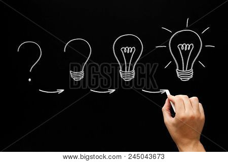 Hand Sketching Idea Growth Process Light Bulbs Concept With White Chalk On Blackboard.
