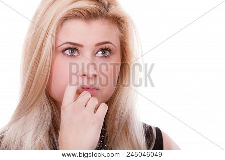 Closeup Portrait Of Thinking Blonde Woman Making Serious Neutral Face, Contemplating About Things An