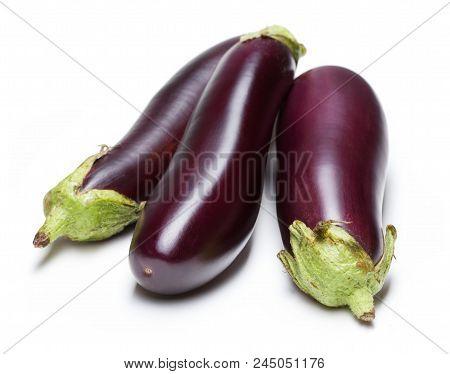 Three Ripe Purple Eggplants Isolated On White Background