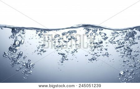 Closeup Of Bubbles In Blue Water On White Background