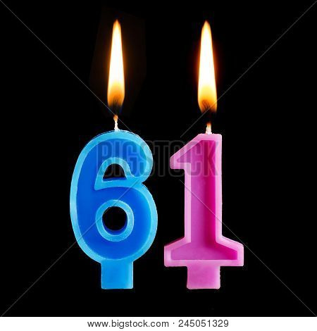 Burning Birthday Candles In The Form Of 61 Sixty One For Cake Isolated On Black Background.