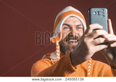 Cheerful Selfie. Handsome Young Man With Beard Makes Self, Smiling. Emotional Hipster Modern Man Usi