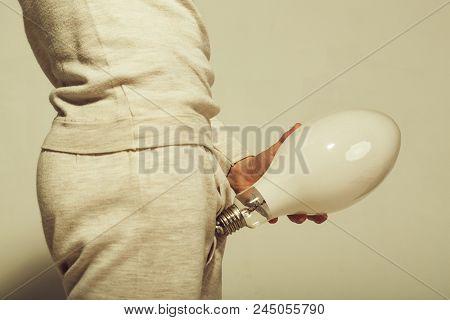 Man With Big Lamp Near Pants. Handjob And Masturbations. Power And Business Success. Energy And Elec
