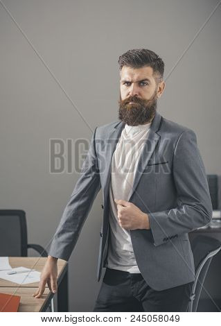 Man With Beard And Mustache On Serious Face. Bearded Man In Casual Suit In Office. Confident Busines