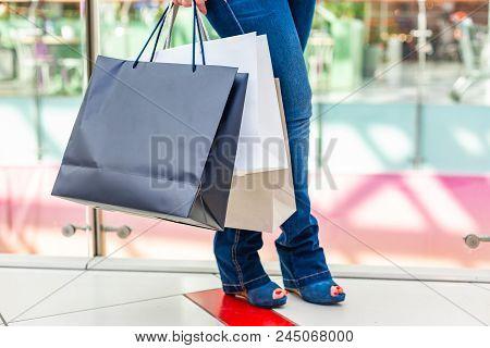 Fashion Shopping Girl Portrait. Beauty Woman With Shopping Bags In Shopping Mall. Shopper. Sales. Sh