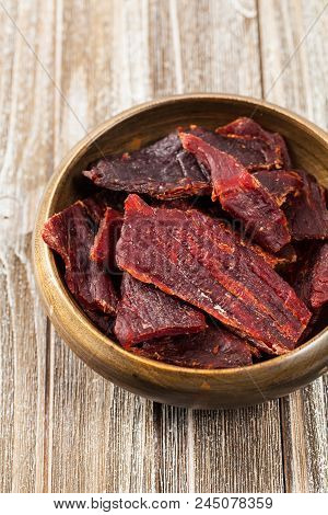 Delicious Homemade Beef Jerky Background. Selective Focus.