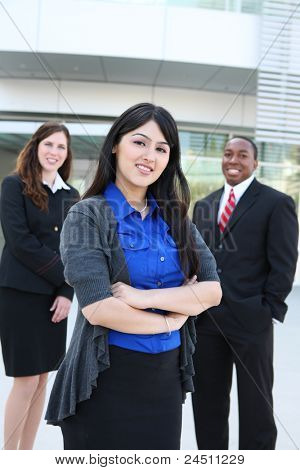 Attractive business man and women team at office building