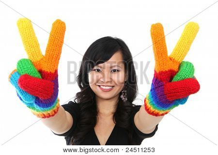 A happy asian woman with rainbow gloves giving peace sign