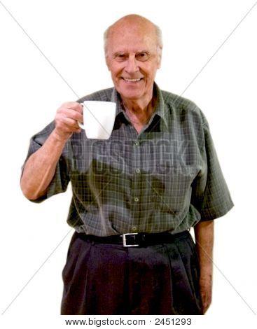 Smiling Senior Holds A Mug