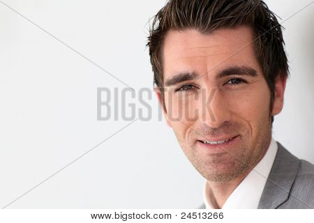 Portrait of businessman on grey background
