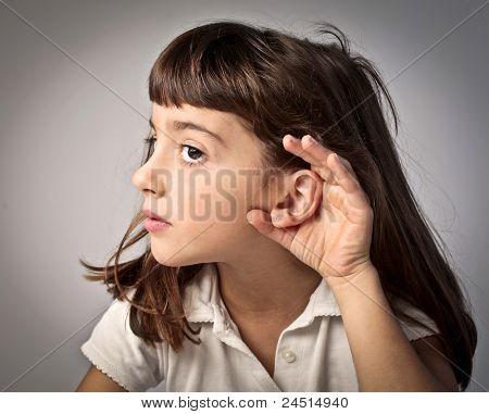 Little girl lending an ear to something