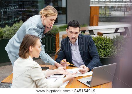 Prosperous Executives. Three Prosperous Executives Feeling Occupied While Having Productive Brainsto