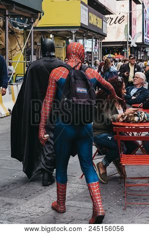 New York, Usa - May 28, 2018: People Dressed In Batman And Spiderman Costumes Walk Through Times Squ