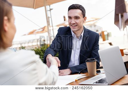 White Collar. Successful White Collar Worker Feeling Very Secure While Shaking Hand Of His Prosperou