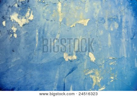 Blue grunge peeling paint abstract background