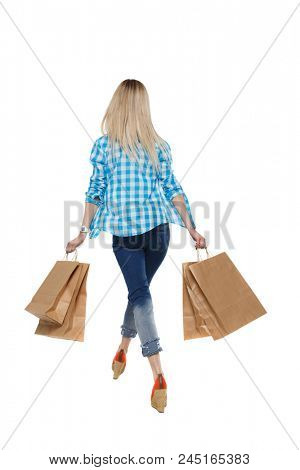 back view of going  woman  with shopping bags . beautiful girl in motion.  backside view of person.  Rear view people collection. Isolated over white background. A happy blonde is waving her shopping.