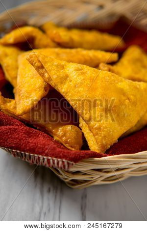 Chinese Cheese Wontons Appetizer At Restaurant Served In Wicker Basket