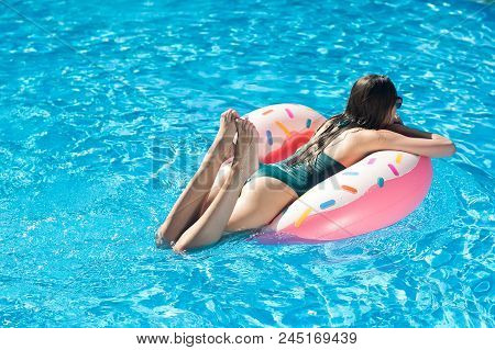 Merriment, Summer, Weather Concept. Floating On The Surface Of Clean Transparent Water Of The Swimmi
