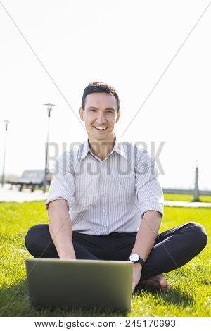 Writing Essay. Prosperous Freelance Writer Feeling Motivated While Writing His Essay Working Outside