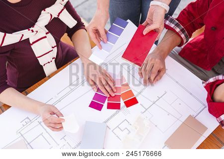 Color Palette. Young Married Couple Feeling Curious While Choosing Color Palette For Their Future Ap