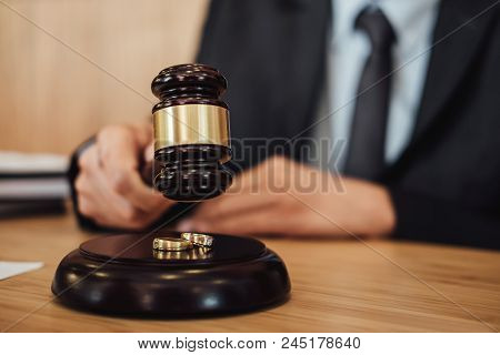 Two Golden Wedding Ring On Gavel, Marriage Divorce On Judge Gavel Deciding.