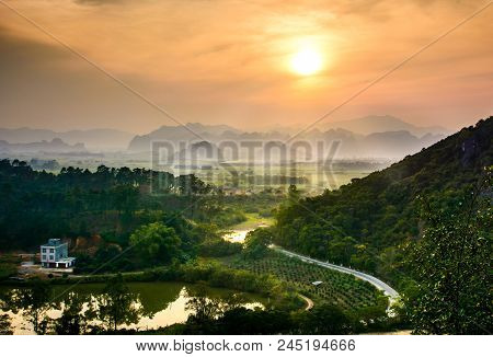 Idyllic Sunset Over Chinese Rice Fields And Nature On Guangxi Province