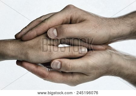 Concept Of Caring, Tenderness, Protection. Male And Female Hands Touch Each Other.