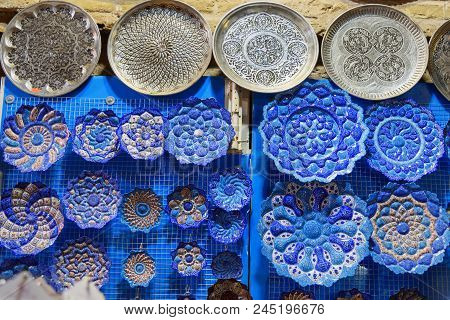 Traditional Iranian Plates And Dishes With Traditional Persian Ornament In Bazaar Of Isfahan. Iran