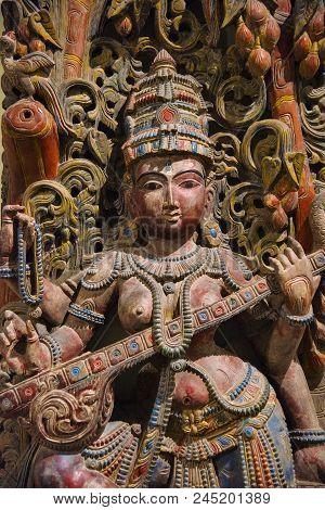 Wooden Idol Of Goddess Saraswati, Egmore, Chennai, India. Located At The Government Museum Or Madras