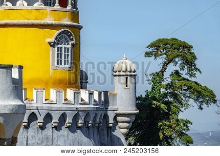 The Impressive Palace Da Pena Corner With Trees In Sintra, Lisbon. Portugal