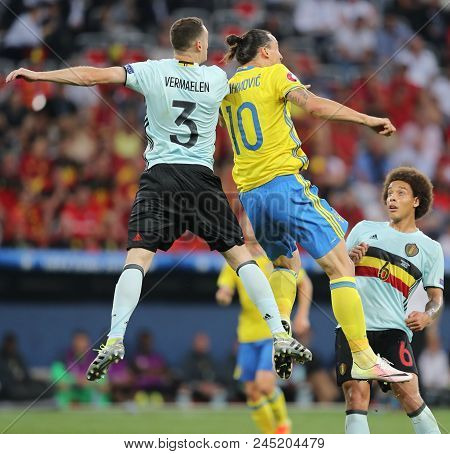 Nice, France - June 22, 2016: Thomas Vermaelen Of Belgium (l) Fights For A Ball With Zlatan Ibrahimo