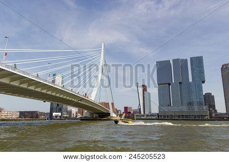 Rotterdam, Netherlands - April 7 2018: Erasmus Suspension Bridge Crossing Busy New Maas River With M