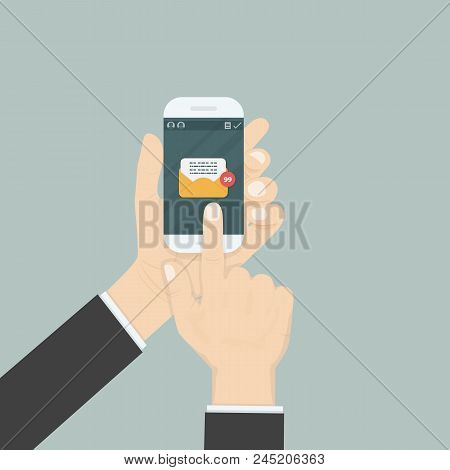 Hand Holding Smartphone And Touching Screen With Text Messaging.smartphone With New Message On Scree